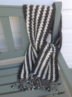 Hand knitted saw-tooth scarf