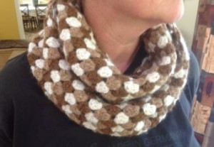 Hand knitted earthy coloured scarf